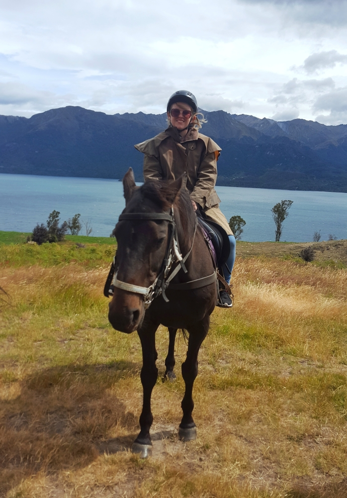 Sitting on a horse on the shores of Lake Wakatipu in New Zealand