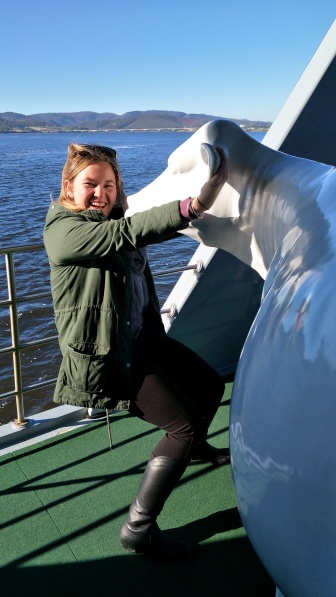 Hanging off the cow on the MONA Ferry
