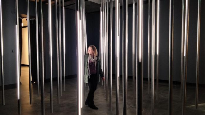 Walking through hanging bars of lights
