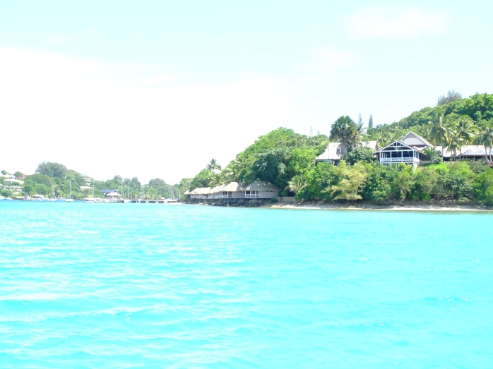 A view of turquoise blue waters and green beaches in Vanuatu