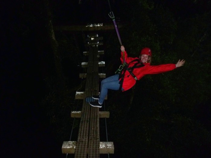 Leaning out over the bridge while zip lining