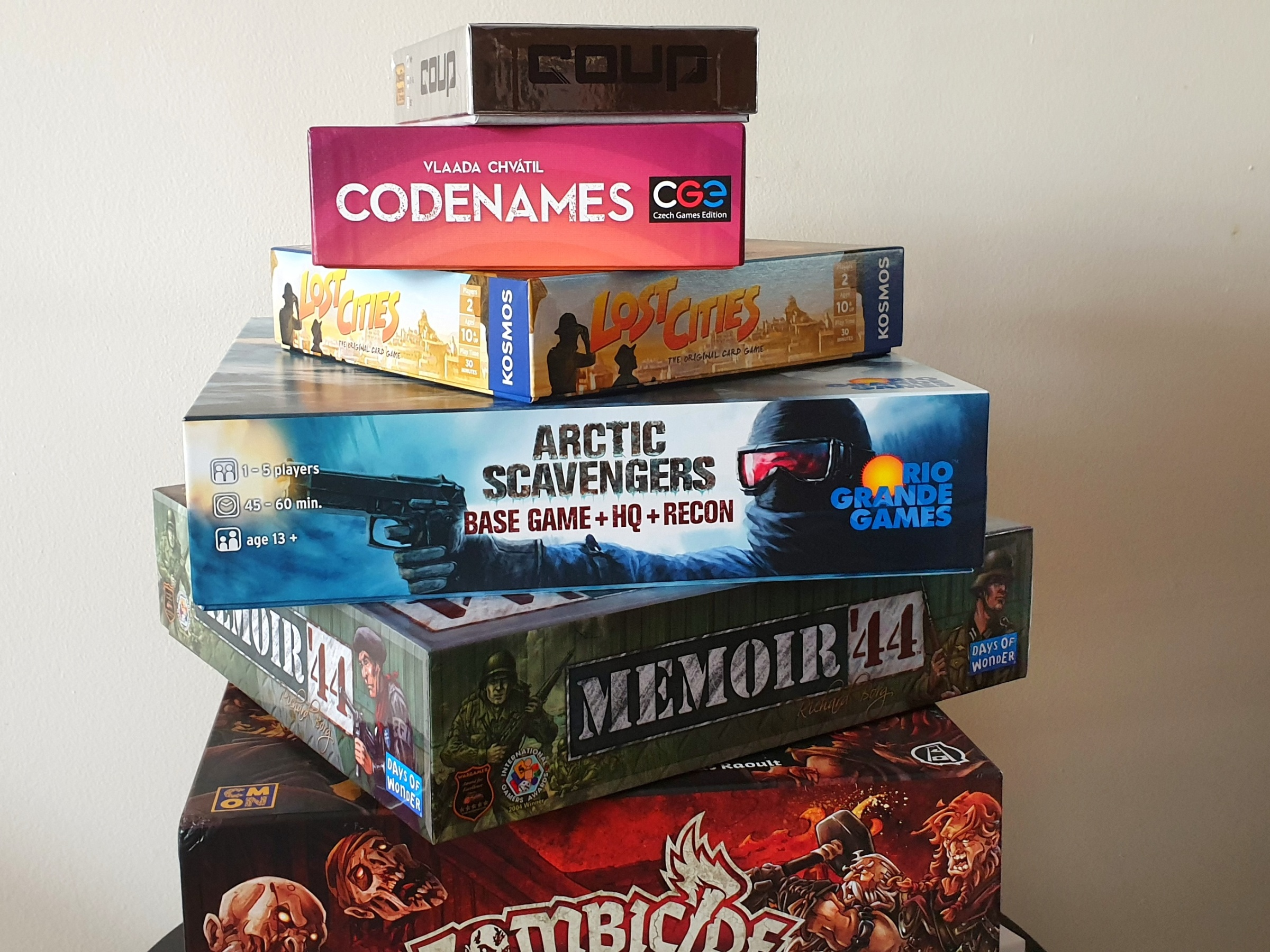 Stack of board games on Chasing Emma
