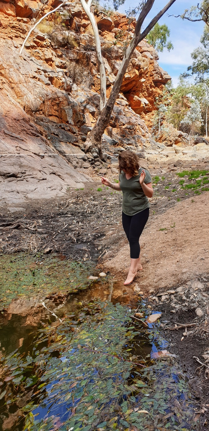 Dipping my toes into the freezing cold water at Serpentine Gorge along the West MacDonnell Ranges