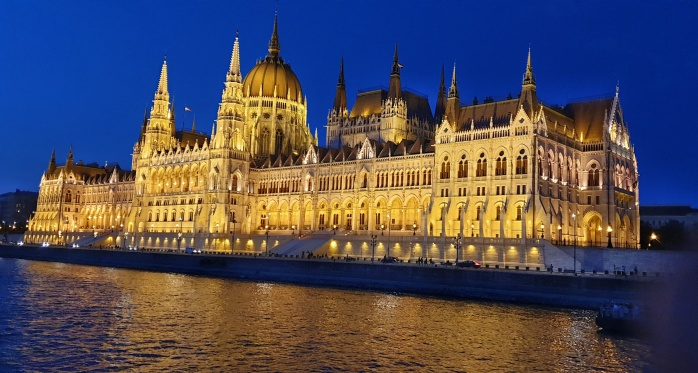 Parliament House lit up at night as seen from the Danube River