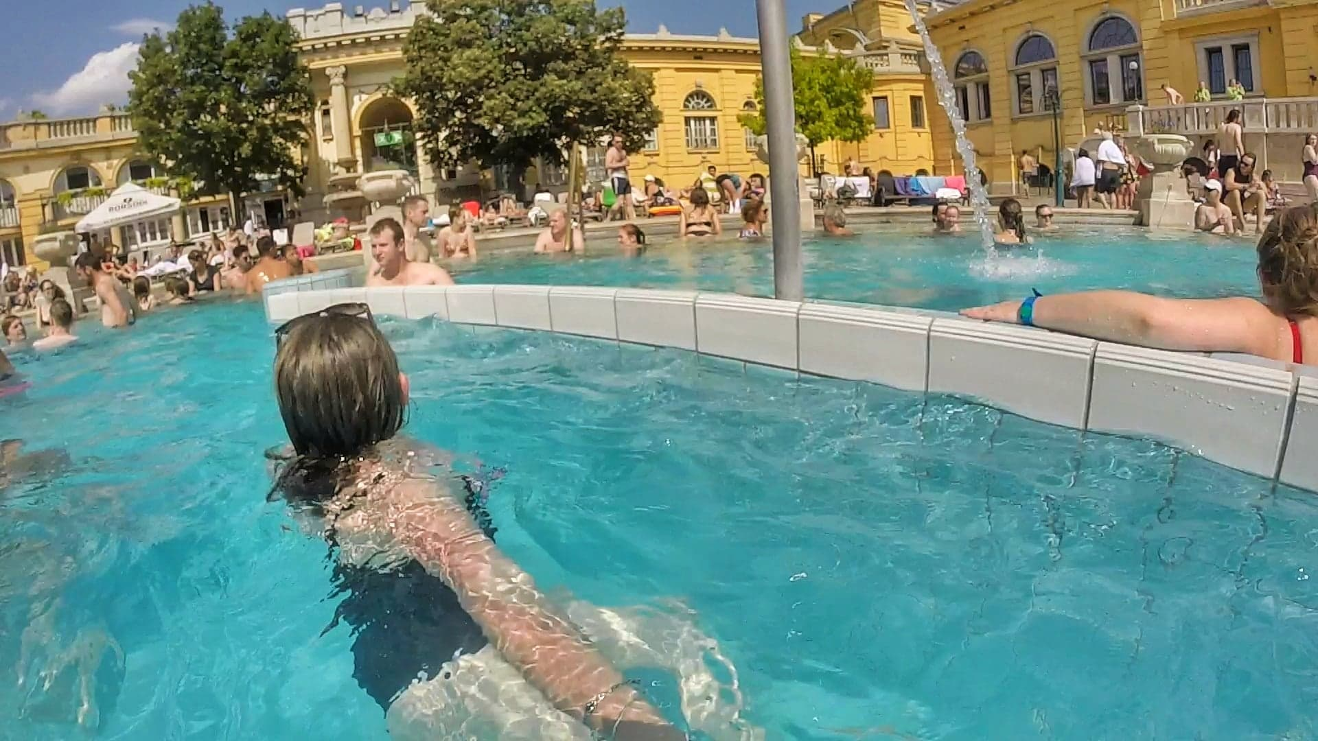 Chasing Emma in the whirlpool in the second semicircular outdoor bath at Szechenyi