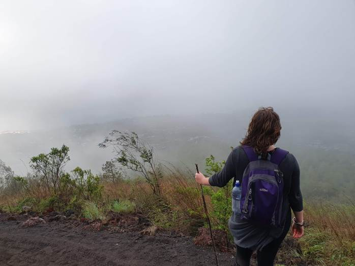 Standing under the clouds on Mt Batur Chasing-Emma.com