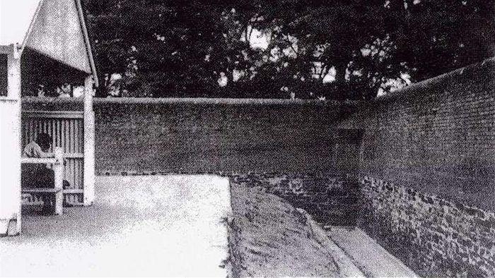 An original photo depicting the haha wall surrounding Z Ward