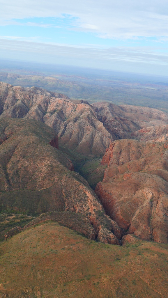 Scenic flight over Hugh Gorge, Australia showing the constrast of reds and greens.